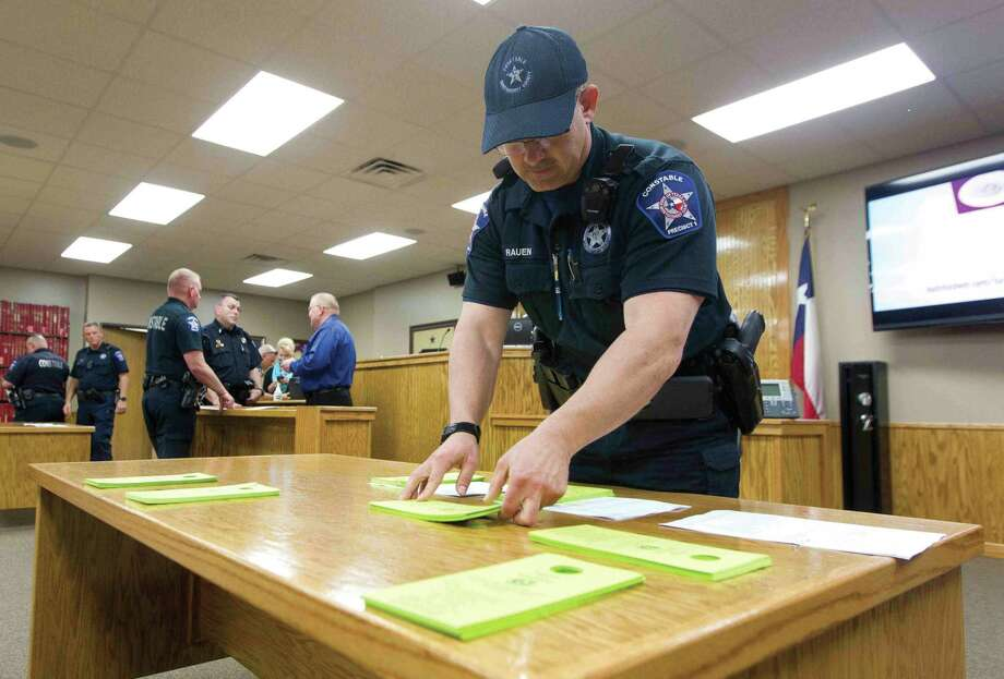 Montgomery County Constable Ray Rauen sorts paperwork before the Precinct 1 warrant roundup Wednesday. Law enforcement agencies throughout Montgomery County gathered to help account for more than 500 outstanding tickets and warrants in Precinct 1. Photo: Jason Fochtman