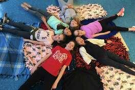 Scotland Elementary School's Junior Girl Scout Troop #50296 members, Charlotte Collins, Ruby Weiner, Gaby Olkoskie, Georgia Anderson, Claire Yang and Isla Dougan. Missing from photo is troop member, Audrey Black.