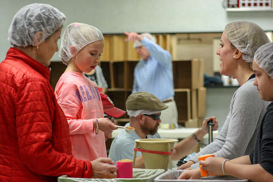 Volunteers sort items for meal packages Saturday morning at the American Legion Post 199, as part of the Edwardsville Rotary Club's annual service project to help Nicaragua families. Photo: For The Intelligencer