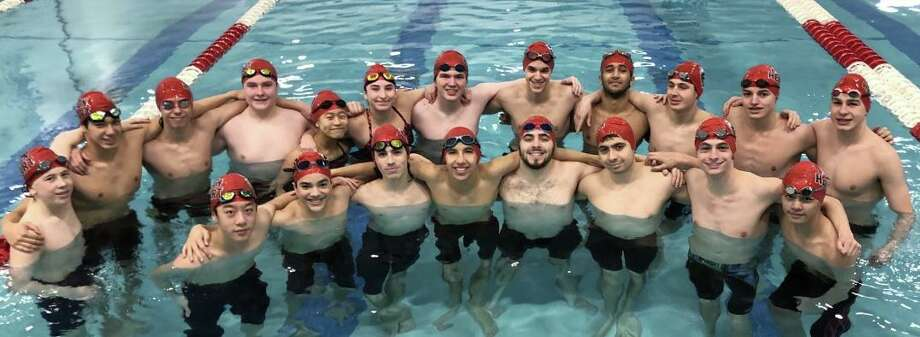 The Milford Co-op boys swim team raised $1,439 through it's Lion Heart fundraiser for breast cancer research. Photo: Contributed Photo / Foran High Athletics / Milford Mirror