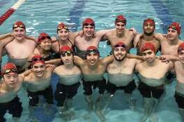 The Milford Co-op boys swim team raised $1,439 through it's Lion Heart fundraiser for breast cancer research.