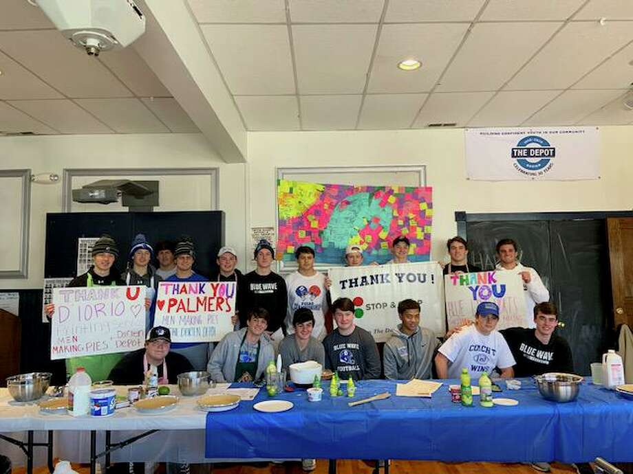 Darien High School Football Team makes pies. Photo: Contributed Photo / Connecticut Post