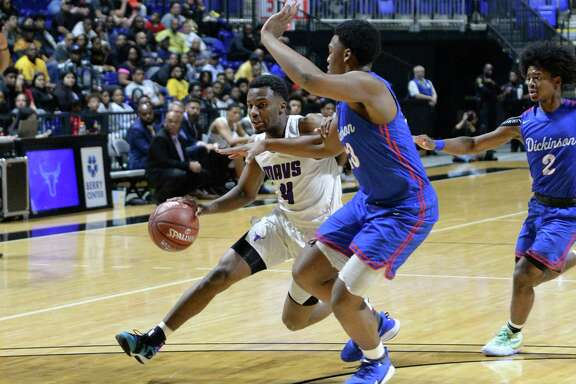 LJ Cryer (4) of Morton Ranch drives the paint during the first quarter of the Boys 6A Region III semifinal basketball game between the Morton Ranch Mavericks and the Dickinson Gators on Friday, March 6, 2020 at the Berry Center, Cypress, TX.
