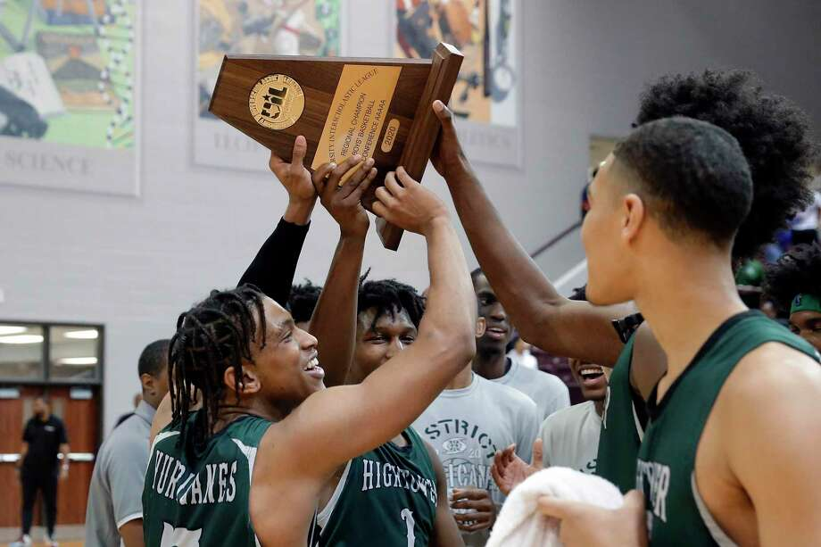 Hightower players hoist the trophy after defeating Shadow Creek in the Class 5A Region III finals basketball game, held at the M.O. Campbell Education Center Saturday, Mar. 7, 2020 in Houston, TX. Photo: Michael Wyke / Contributor / © 2020 Houston Chronicle