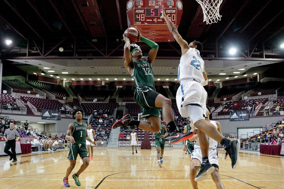 Hightower guard Bryce Griggs drives up a shot as Shadow Creek forward Trey Hartfield defends during the Class 5A Region III finals basketball game, held at the M.O. Campbell Education Center Saturday, Mar. 7, 2020 in Houston, TX. Photo: Michael Wyke / Contributor / © 2020 Houston Chronicle