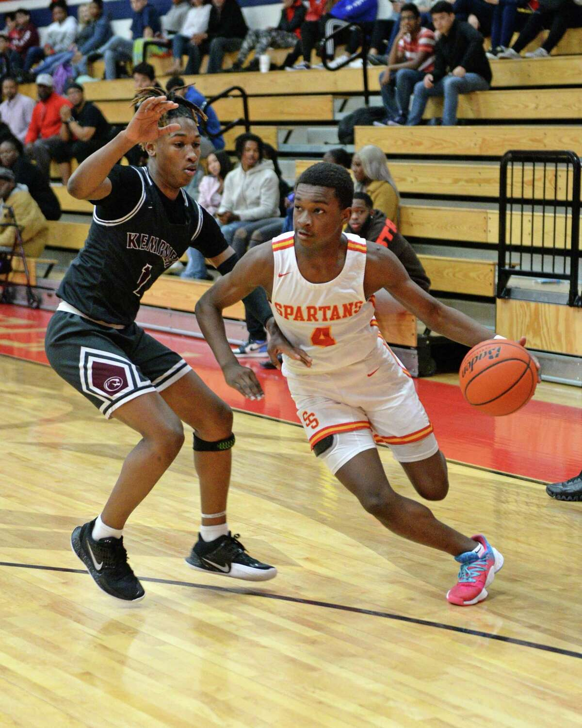 Daylan Presley (4) of Stafford drives toward the basket during pool play of the Fort Bend ISD Invitational Boys Basketball Tournament between the Kempner Cougars and the Stafford Spartans on Thursday, December 12, 2019 at Dulles HS, Sugar Land, TX.