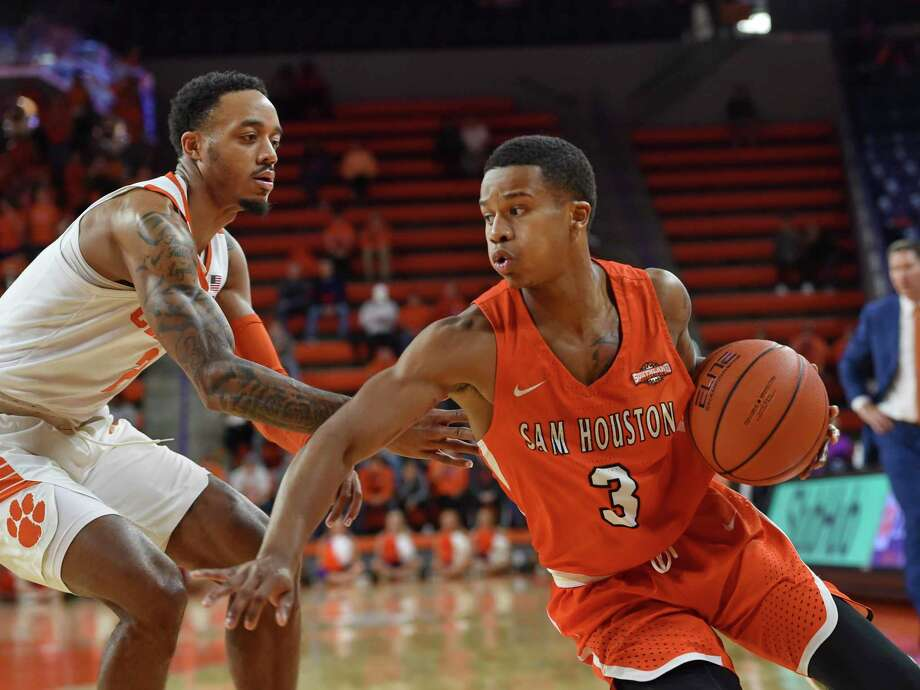 Sam Houston State's Chad Bowie (3) drives down the baseline while defended by Clemson's Marcquise Reed during the first half of an NCAA college basketball game Wednesday, Nov. 14, 2018, in Clemson, S.C. (AP Photo/Richard Shiro) Photo: Richard Shiro, FRE / Associated Press / Copyright 2018 The Associated Press. All rights reserved.