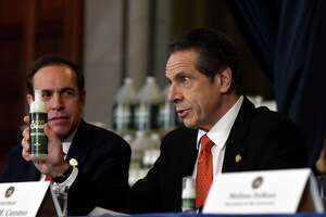 Gov. Andrew Cuomo is joined by State Department of Health Commissioner Dr. Howard Zucker, left, as he announced a new state hand sanitizer to better combat coronavirus during a news briefing on Monday, March 9, 2020, in the Red Room at the Capitol in Albany, N.Y. (Will Waldron/Times Union)