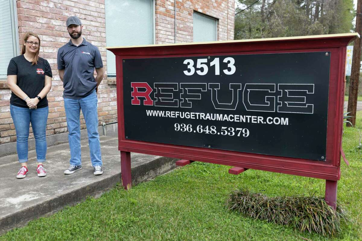 Ashley Greer (left) and Refuge founder, Adam Wilson, pose next to the Refuge sign in Conroe, Thursday, March 5, 2020. Refuge is a trauma and counseling center specializing in cognitive behavior therapy (CBT) and eye movement desensitization/reprocessing (EMDR).