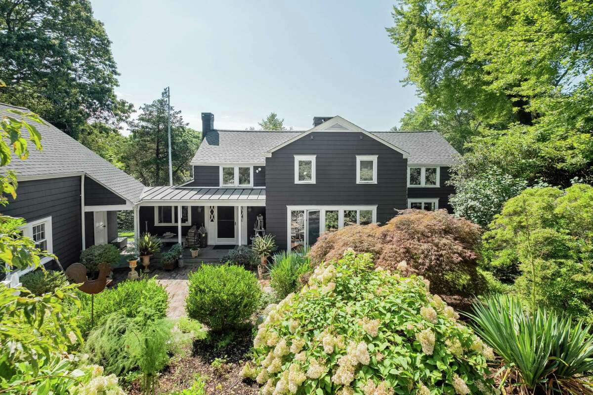 The unique estate at 65 Kettle Creek Road in Lower Weston features a main house, guest house and accessory apartment on a beautifully landscaped 1.8-acre level and sloping property.