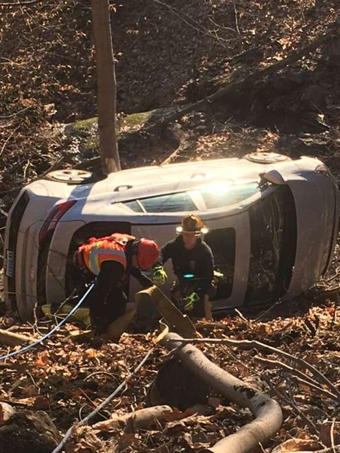 A one-vehicle accident on River Road Monday, March 9, required emergency crews to perform a rope rescue. Photo: Shelton Fire Department / Contributed Photo / Connecticut Post