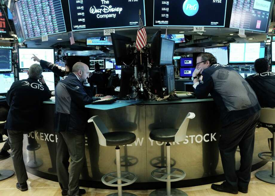 Traders on the floor of the New York Stock Exchange on March 9. Trading was halted for 15 minutes after the opening bell as stocks fell 7% amid escalating coronavirus fears.  Photo: CBSI/CNET