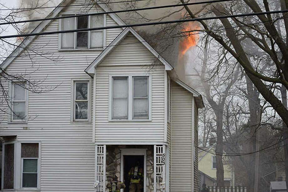 Firefighters tackle a residential fire at 503 N. Prairie St. Photo: Samantha McDaniel-Ogletree | Journal-Courier