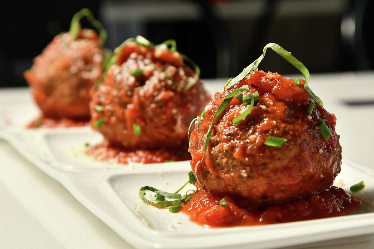 House-made meatballs with marinara at Porta'Vino at 7800 Washington Ave.