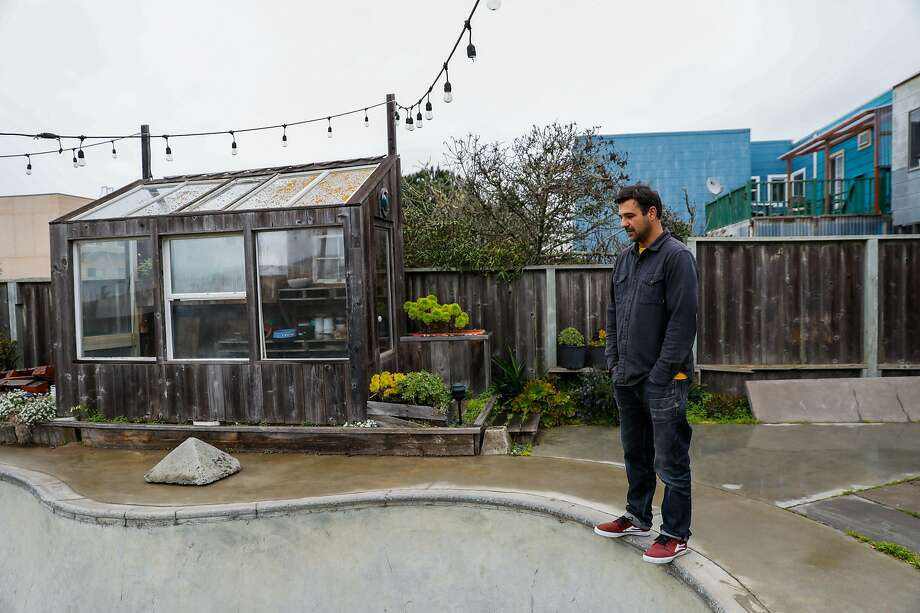 Artist George Rocha outside the concrete bowl he installed for skateboarding in his backyard on Tuesday, Jan. 21, 2020 in San Francisco, California. He runs Iris Skateboards which repurposes skateboards to make furniture, skateboards and other objects. Photo: Gabrielle Lurie / The Chronicle