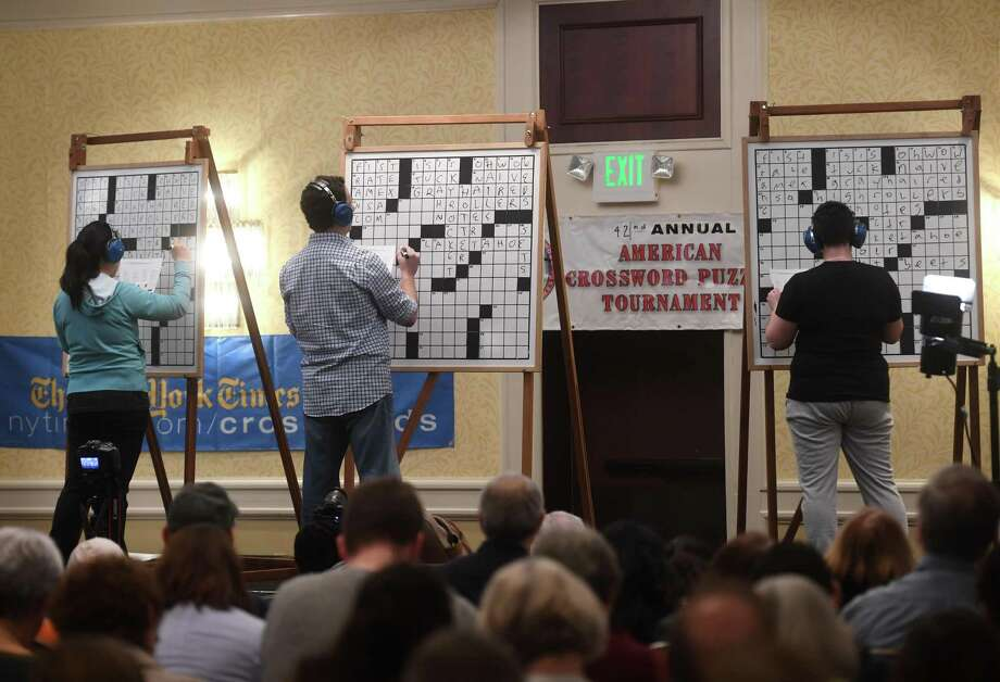 C division contestants complete the championship playoff puzzle on stage at the 42nd Annual American Crossword Puzzle Tournament at the Stamford Marriott in Stamford, Conn. on Sunday, March 24, 2019. The division was won by Lily Geller, left, of Brooklyn, New York. Photo: Brian A. Pounds / Hearst Connecticut Media / Connecticut Post
