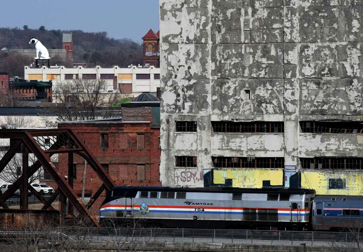 A westbound Amtrak train heads past Central Warehouse on Monday, March 9, 2020, in Albany, N.Y. (Will Waldron/Times Union)