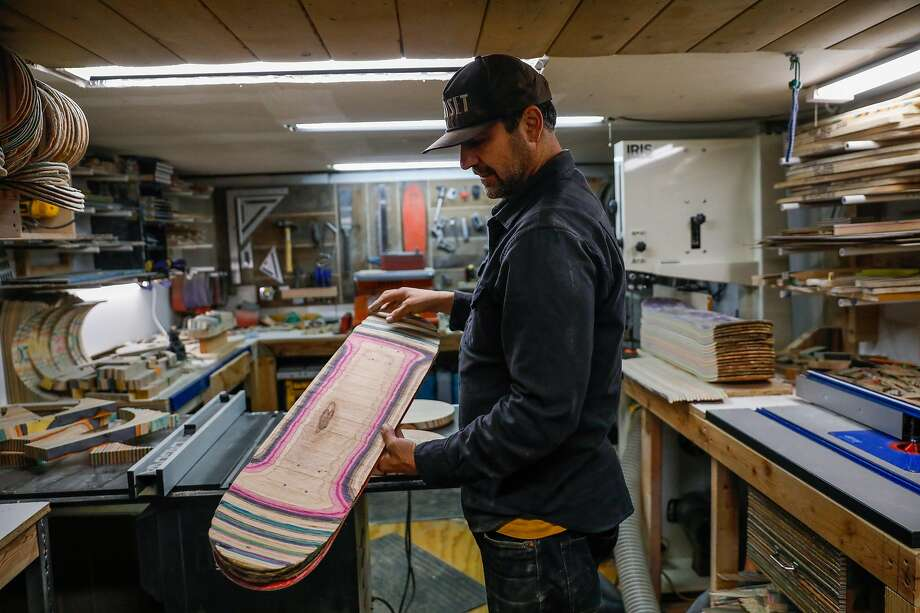 Artist George Rocha shows off a piece of a broken skateboard at his workshop Iris Skateboards on Tuesday, Jan. 21, 2020 in San Francisco, California. He repurposes skateboards to make furniture, skateboards and other objects for his brand Iris Skateboards. Photo: Gabrielle Lurie / The Chronicle