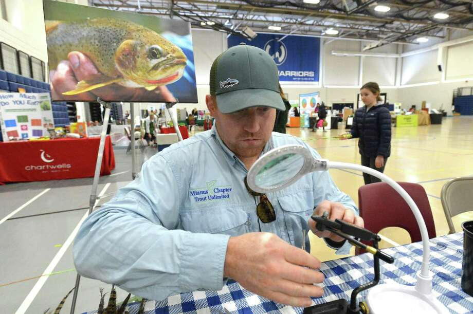 Ben Couch ties a pheasant tail Nymph fly during a demonstration at Wilton's Zero Waste Faire in 2018. This year's Zero Waste Faire and Sustainable Living Expo scheduled for Sunday, March 29, has been canceled as a precaution to prevent the spread of the coronavirus. Photo: File Photo / Hearst Connecticut Media / Norwalk Hour