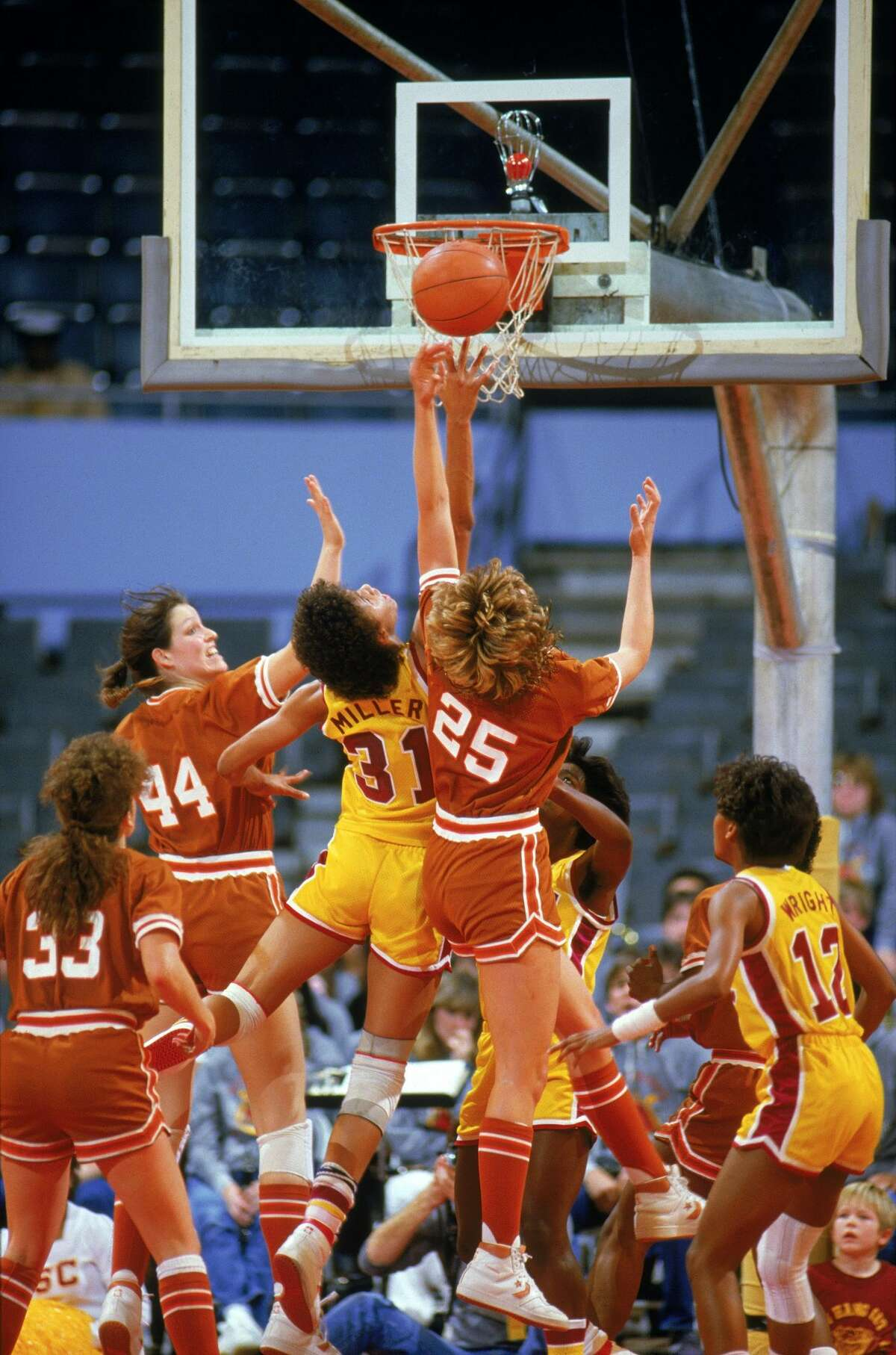 AUSTIN, TX - Cheryl Miller #31 of USC Trojans puts a shot up during a women basketball game against Texas Longhorns in Austin, Texas. Cheryl Miller's college career lasted from 1983-1986. (Photo by: Rick Stewart/Getty Images)