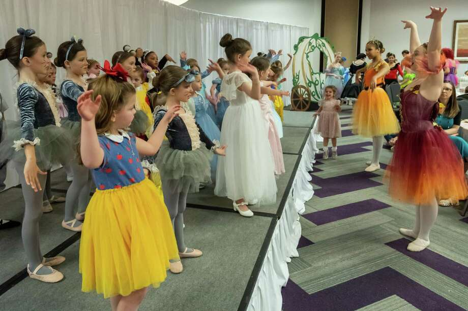 Little princesses learn the dance moves of the Cinderella ballet production as the Beaumont Ballet Theatre of the Bonnie Cokinos School of Dance held their Cinderella Story Time Tea for young princesses at the Holiday Inn on March 7, 2020.  Fran Ruchalski/The Enterprise Photo: Fran Ruchalski/The Enterprise / 2019 The Beaumont Enterprise