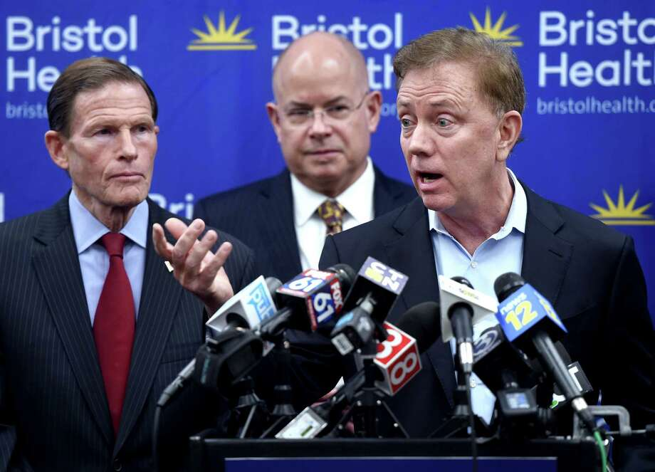 From left, U.S. Senator Richard Blumenthal and Bristol Health President and CEO Kurt Barwis listen to Governor Ned Lamont speak about coronavirus preparedness and response efforts in the state during a press conference at Bristol Hospital on March 9, 2020. Photo: Arnold Gold, Hearst Connecticut Media / New Haven Register