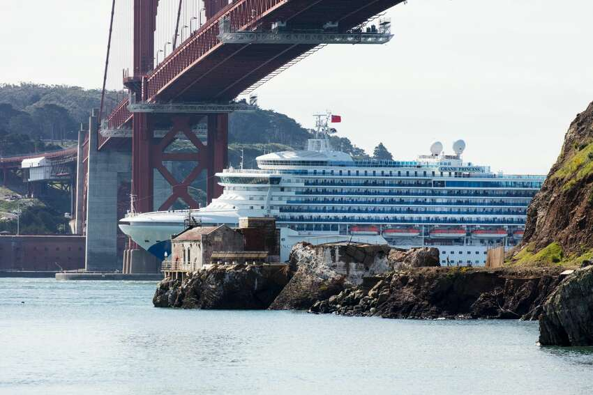 The Grand Princess cruise ship passes under the Golden Gate Bridge as it heads in to dock in Oakland on March 09, 2020. More than 3,000 passengers are stuck at sea after at least 21 people tested positive for the novel coronavirus (COVID-19) on-board.