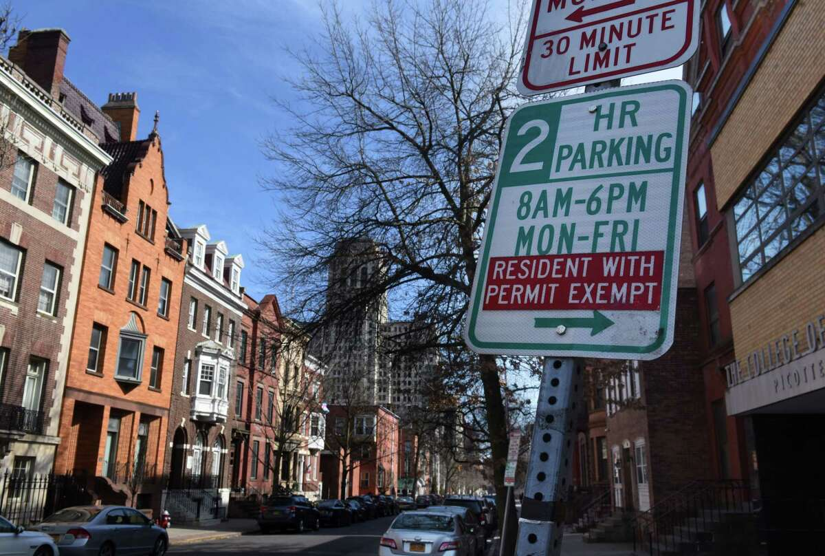 A residential parking permit sign is seen on Monday, March 9, 2020, on State Street near the Capitol in Albany, N.Y. The city is asking the state Legislature to make its residential parking permit system permanent and expand the zone to a mile from the the Empire State Plaza. (Will Waldron/Times Union)