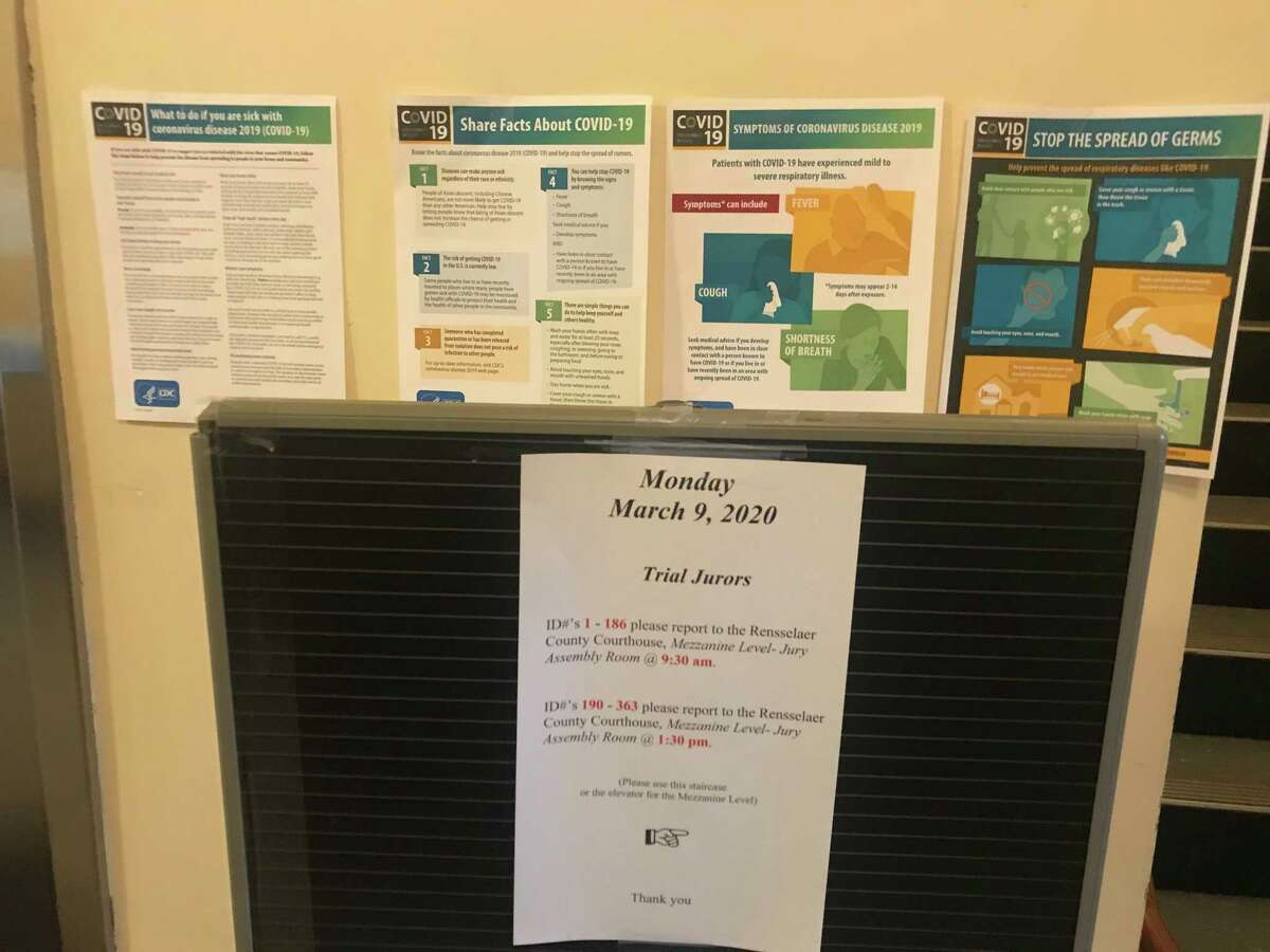 The sign directing where trial jurors were to report at the Rensselaer County Court House Monday March 9, 2020 was backed up by warnings posted about the coronavirus.