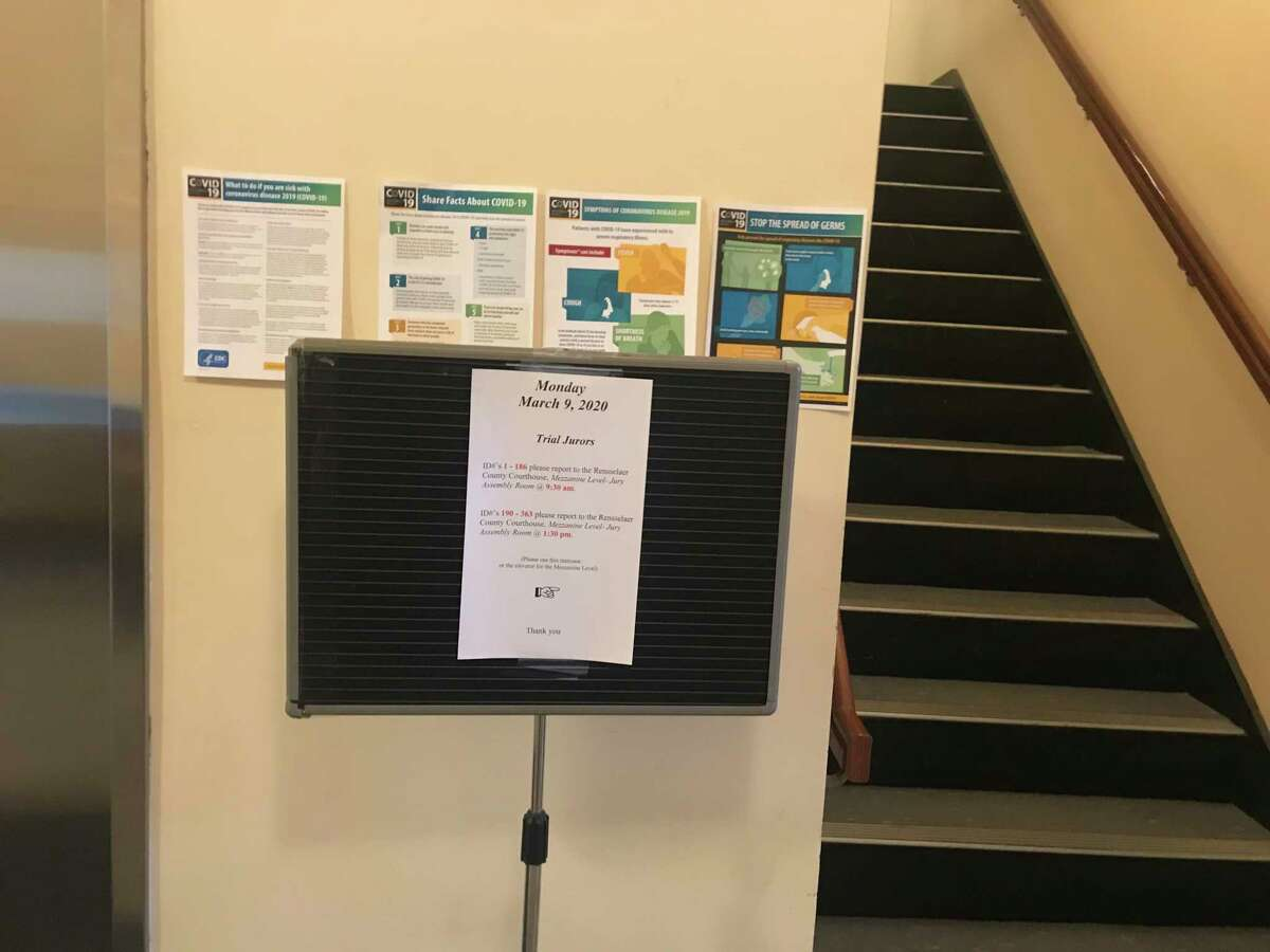 The sign directing jurors where to report at the Rensselaer County Court House Monday March 9, 2020 was posted at the stairs leading to the jury assembly room.  Right behind it were the signs warning about coronavirus.