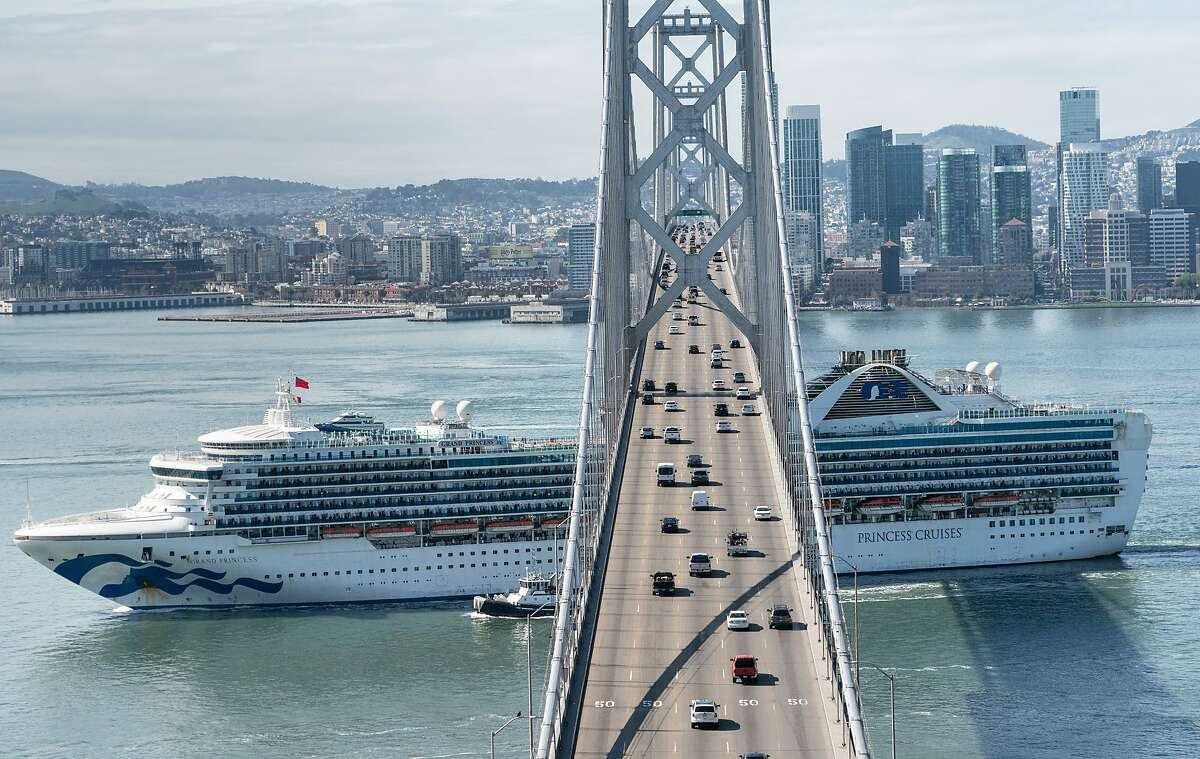 The Grand Princess heads to the Port of Oakland for quarantine due to the coronavirus on Monday, March 9, 2020, in Treasure Island, Calif.