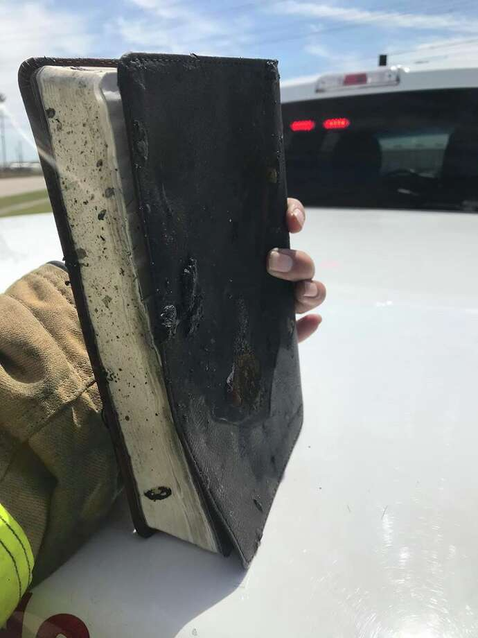 Sunday afternoon the Deer Park Fire Department was dispatched to a truck engulfed in flames on Battleground Rd. The woman driving was uninjured. Upon searching the truck, a bible and a notebook that belonged to the driver were seemingly untouched. Photo: Courtesy Deer Park Fire Dept./Facebook