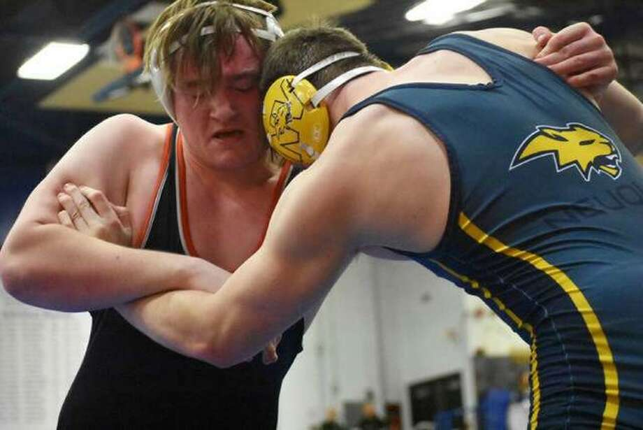 Edwardsville's Blake Moss, left, fights for position in his 220-pound consolation semifinal match at the Class 3A Quincy Sectional. Photo: Matt Kamp/The Intelligencer