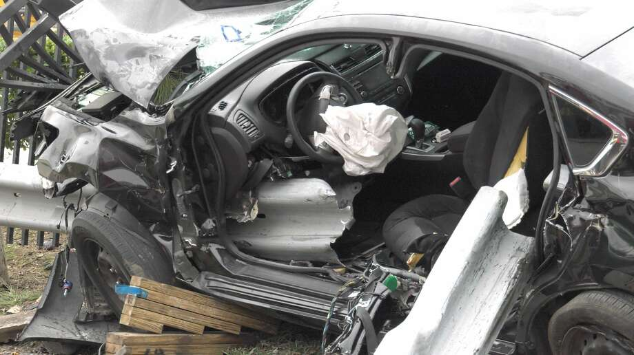 Firefighters rescued a man trapped inside a mangled car Monday, March 9, 2020. A guard rail impaled the car and pinned the man inside by his leg. Photo: Jay R. Jordan / Houston Chronicle