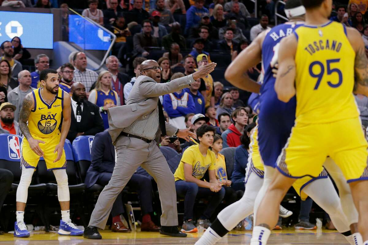 Golden State Warriors associate head coach Mike Brown reacts as the Philadelphia 76ers turn possession over to the Warriors late in the fourth quarter of an NBA game at Chase Center on Saturday, March 7, 2020, in San Francisco, Calif. The Warriors won 118-114.