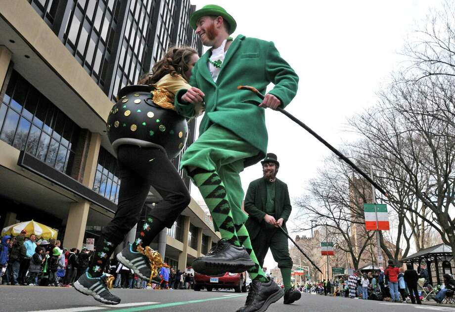 """New Haven--""""The Crowleys,"""" siblings from Milford, do a jig in the St. Patrick's Day parade Sunday in New Haven. Photo by Brad Horrigan/New Haven Register-03.13.11."""