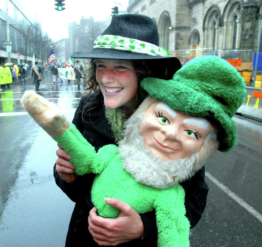 Kristie Barber of the New Haven Ancient Order of Hibernians carries Shamus down Chapel St. during the annual St. Patrick's Day Parade in New Haven on 3/14/2010. Photo by Arnold Gold AG0355F