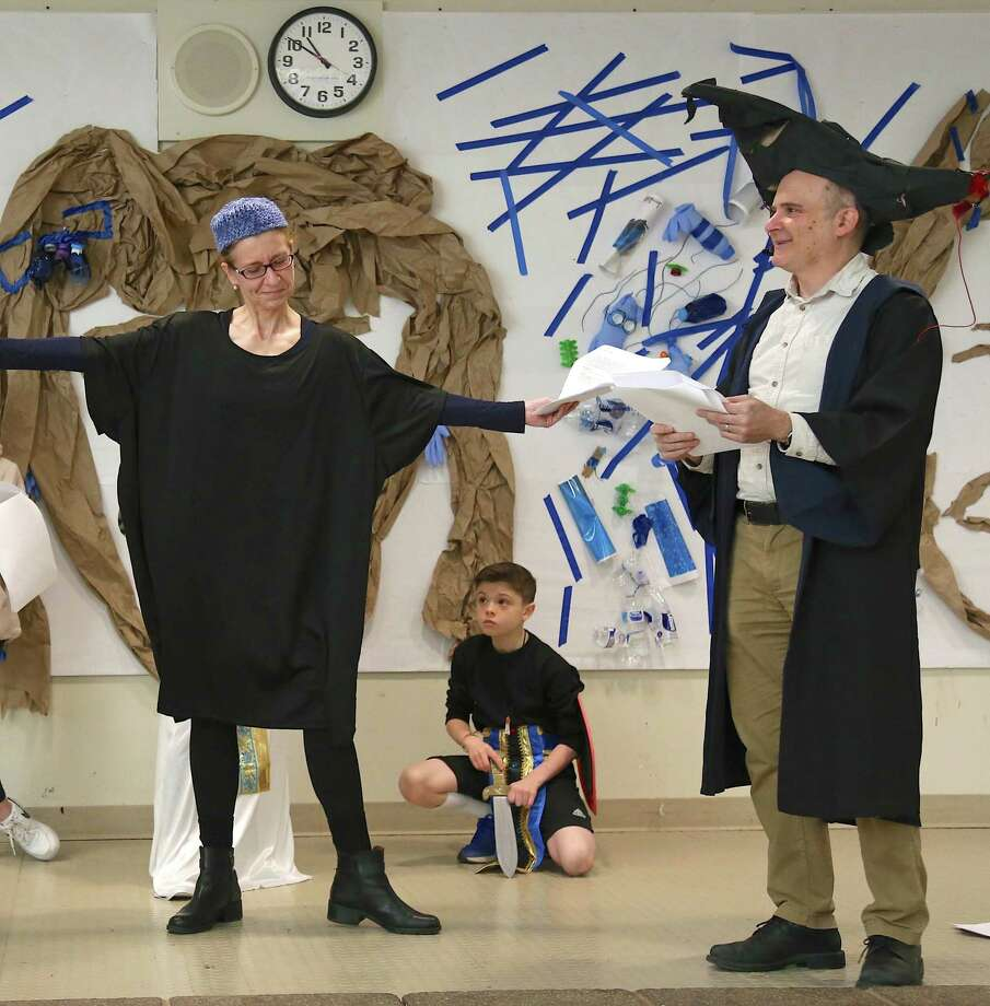 Lore Gruenbaum of Greenwich, at left, brings the traditional play to a close as Mordecai at the Congregation of Humanistic Judaism's Purim celebration at Bedford Middle School on Sunday, March 8, 2020, in Westport, Conn. Photo: Jarret Liotta / For Hearst Connecticut Media / Jarret Liotta / ©Jarret Liotta 2020