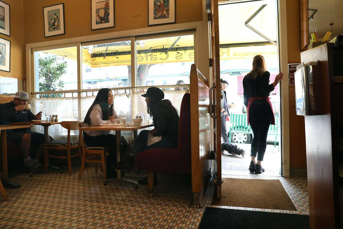 Tenth year where Elyssa Valtier (left) has lunch with her mother Evelyn Valtier (middle) at Rosie�s cafe which usually has a line at the door at right during lunch time on Monday, March 9, 2020, in San Francisco, Calif.. Business at Rose's Cafe is down about twenty percent.
