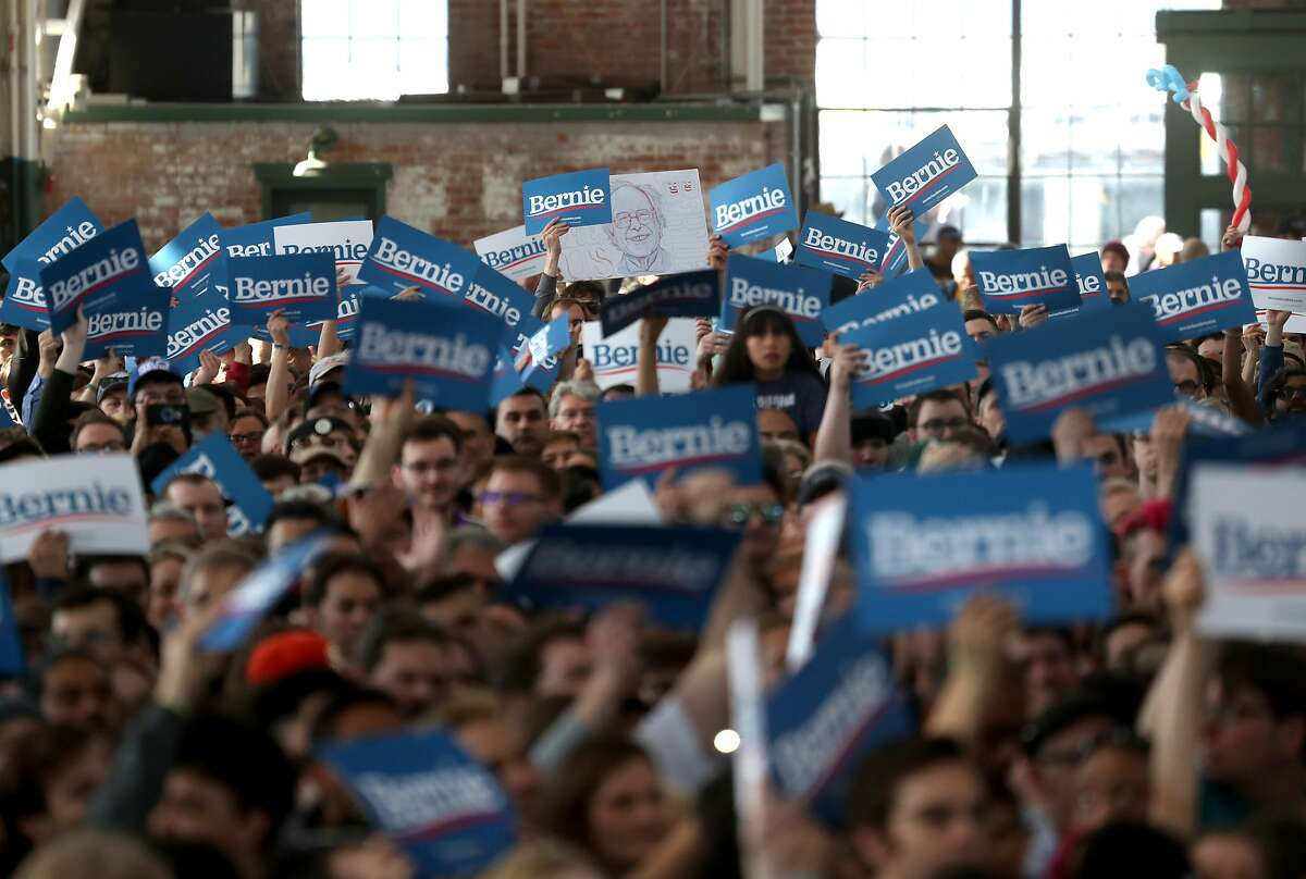 RICHMOND, CALIFORNIA - FEBRUARY 17: Attendees hold signs for Democratic presidential candidate Sen. Bernie Sanders (I-VT) during a campaign event on February 17, 2020 in Richmond, California. Bernie Sanders is campaigning in California ahead of the state's Democratic presidential primary on March 3rd. (Photo by Justin Sullivan/Getty Images)