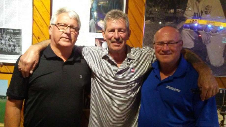 Jim Wright (left) poses with former McArdle teammates Owen Walford (center) and Jack Starling during a 2016 reunion at The Boulevard. Photo: Daily News File Photo