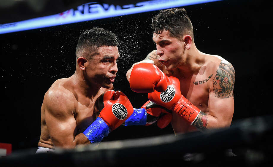 Laredoans head to watch local boxers and MMA fighters go up against other talent from around Texas, Friday, Mar. 7, 2020, at the Sames Auto Arenaa. Photo: Danny Zaragoza / Laredo Morning Times