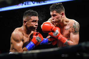 Laredoans head to watch local boxers and MMA fighters go up against other talent from around Texas, Friday, Mar. 7, 2020, at the Sames Auto Arenaa.