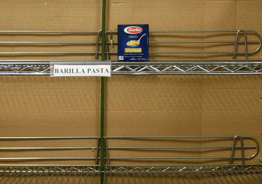 The pasta shelf is nearly empty at the Food Bank of Lower Farifield County in Stamford on Monday, Photo: Tyler Sizemore / Hearst Connecticut Media / Greenwich Time