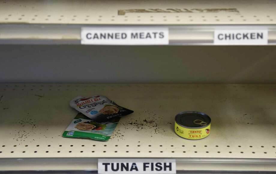 The tuna fish shelf is nearly empty at the Food Bank of Lower Farifield County in Stamford, Conn. Monday, March 9, 2020. Since the coronavirus outbreak, the food bank has experienced a shortage of food, particularly pasta, cereal and nonperishable canned goods. Photo: Tyler Sizemore / Hearst Connecticut Media / Greenwich Time