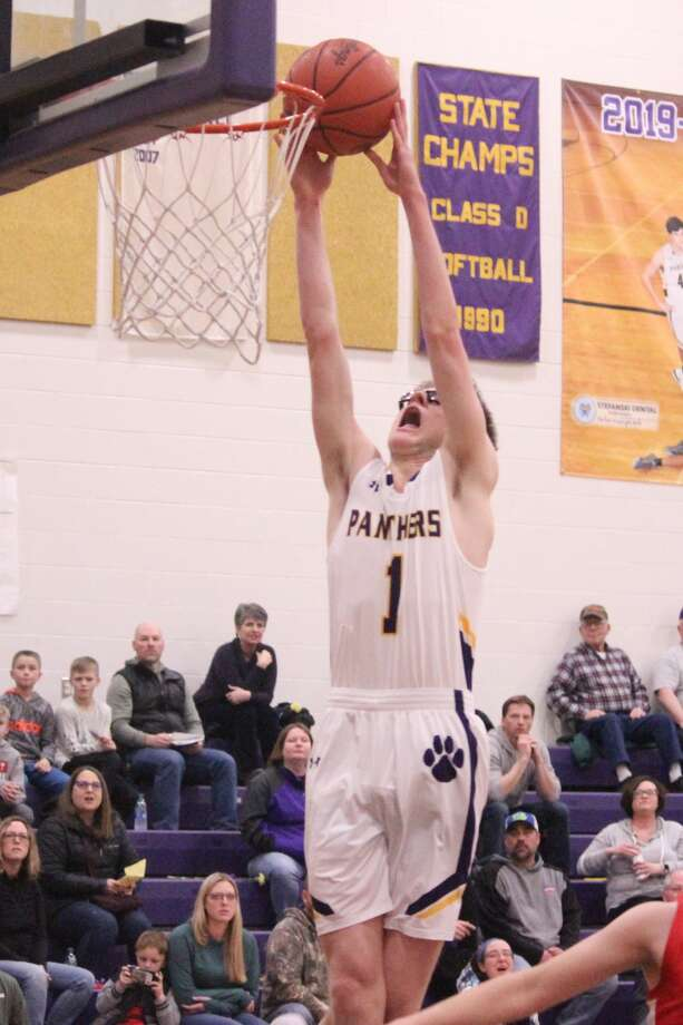 Blake Miller flies high to slam down a dunk in transition after stealing the ball on the other end of the court. Photo: Robert Myers