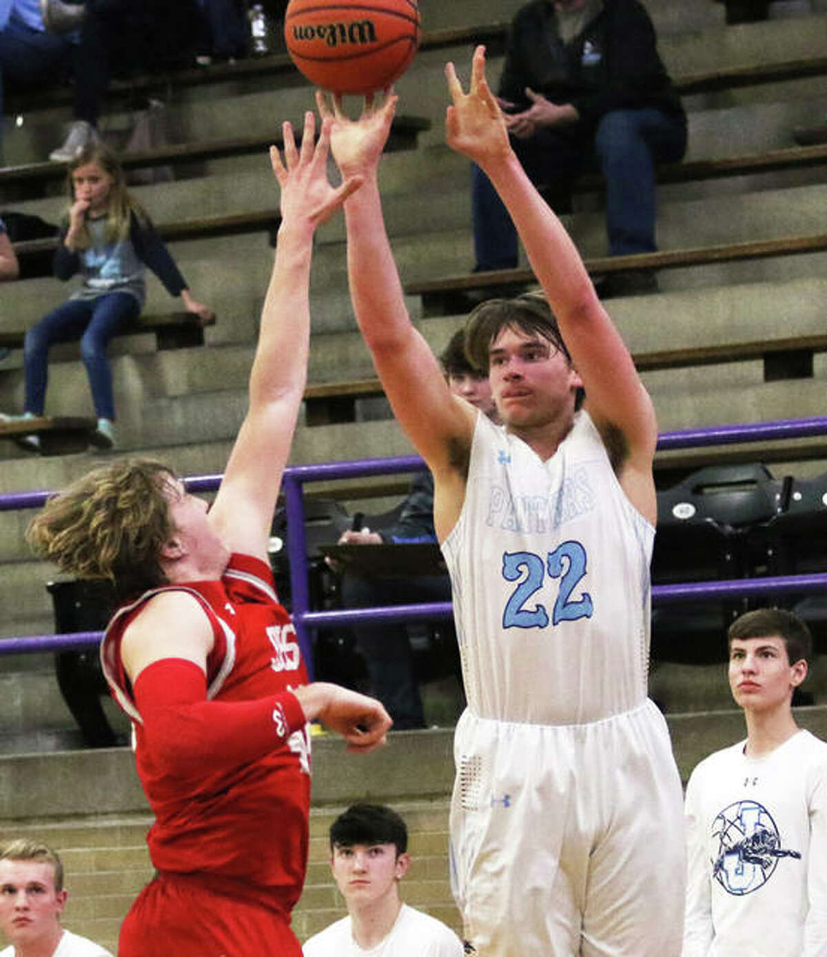 Jersey's Tucker Shalley (22) launches a 3-pointer over Jacksonville's Drew Ezard during a Wednesday night semifinal at the Taylorville Class 3A Regional. Shalley scored 25 points in the Panthers' loss.