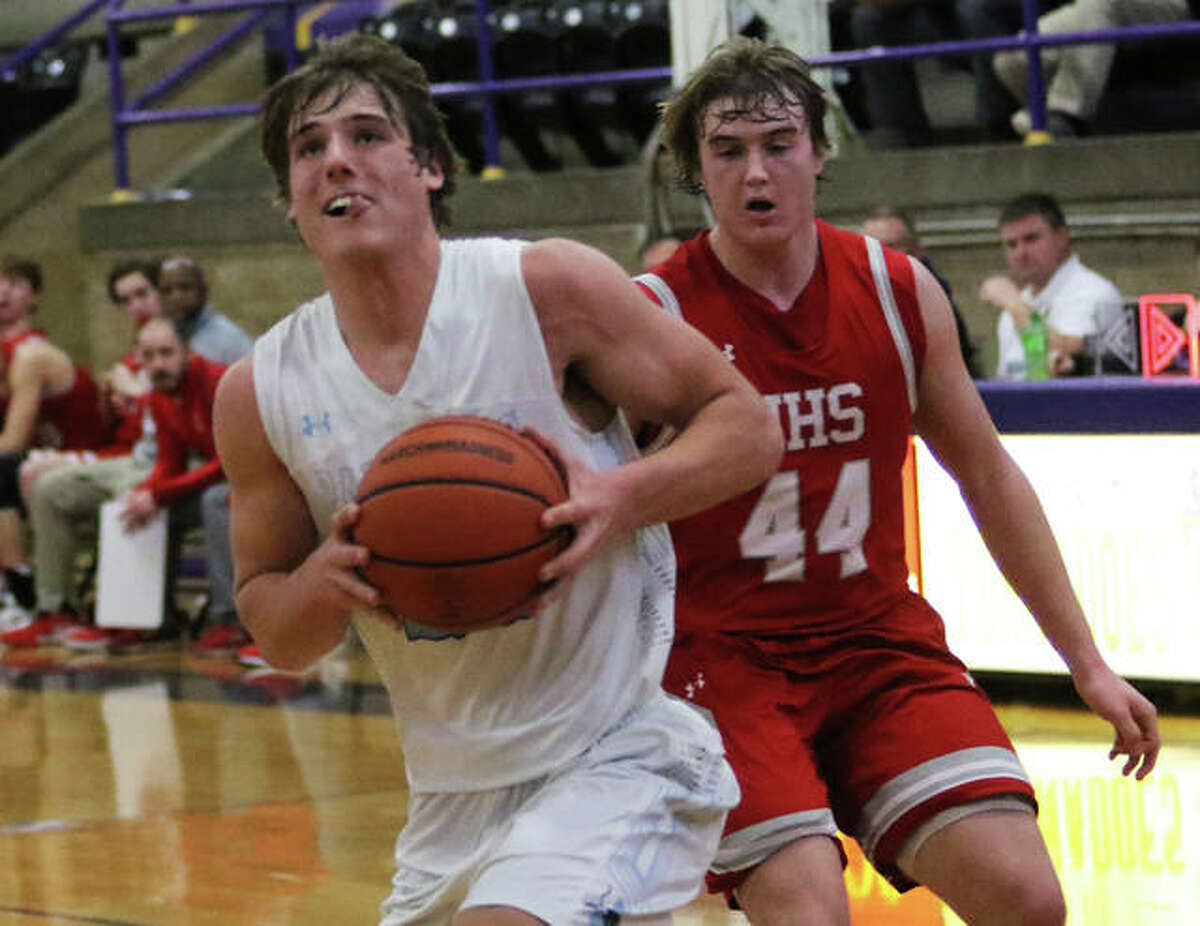 Jersey's Matthew Jackson looks to the basket for his dunk after beating Jacksonville's Drew Ezard (44) down court with a steal Wednesday night in a semifinal at the Taylorville Class 3A Regional.