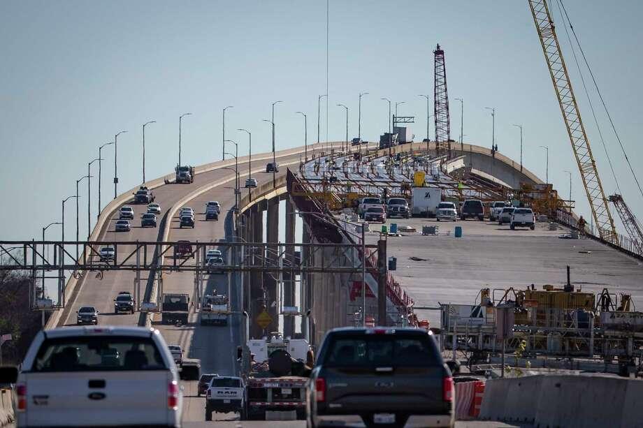 A file photo shows both the existing Ship Channel bridge and the one under construction on the Sam Houston Tollway. Photo: Mark Mulligan, Houston Chronicle / Staff Photographer / © 2020 Mark Mulligan / Houston Chronicle