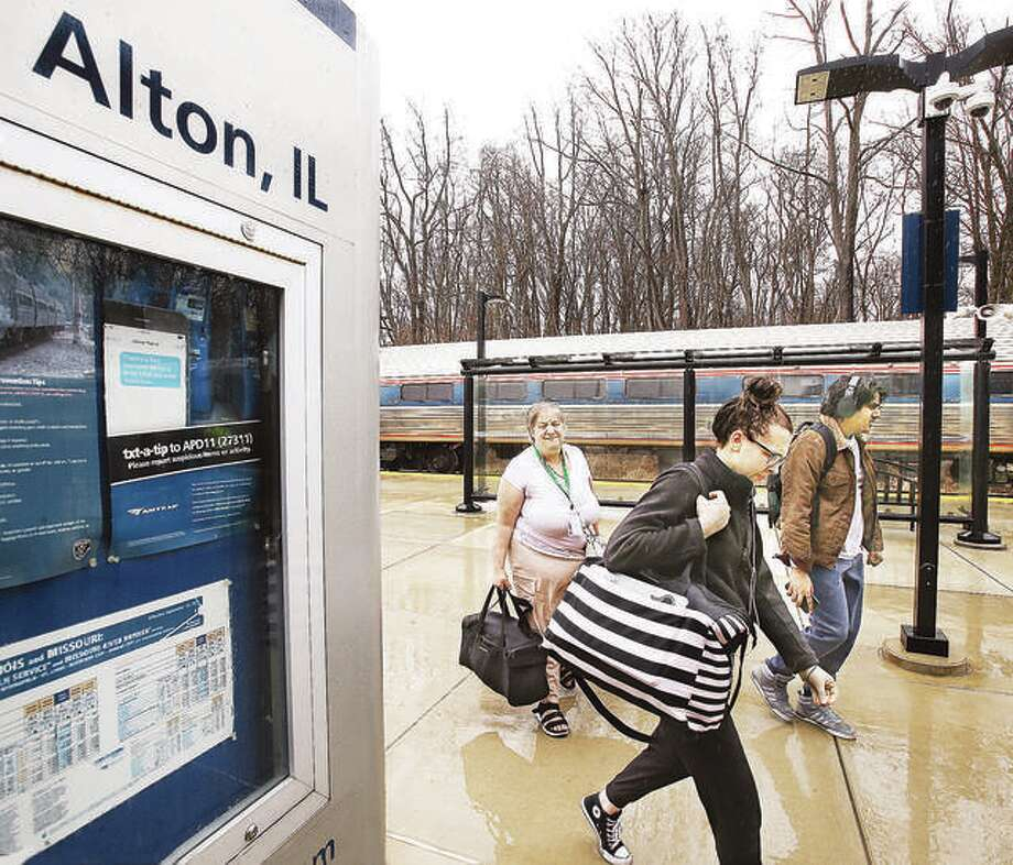 Passengers headed south on Amtrak unload Monday at the Alton Multimodal Transportation Center. Concerns have been raised over a passenger who passed through Alton on an Amtrak train March 4, with the COVID-19 virus. That train has since been taken out of service and is being disinfected.